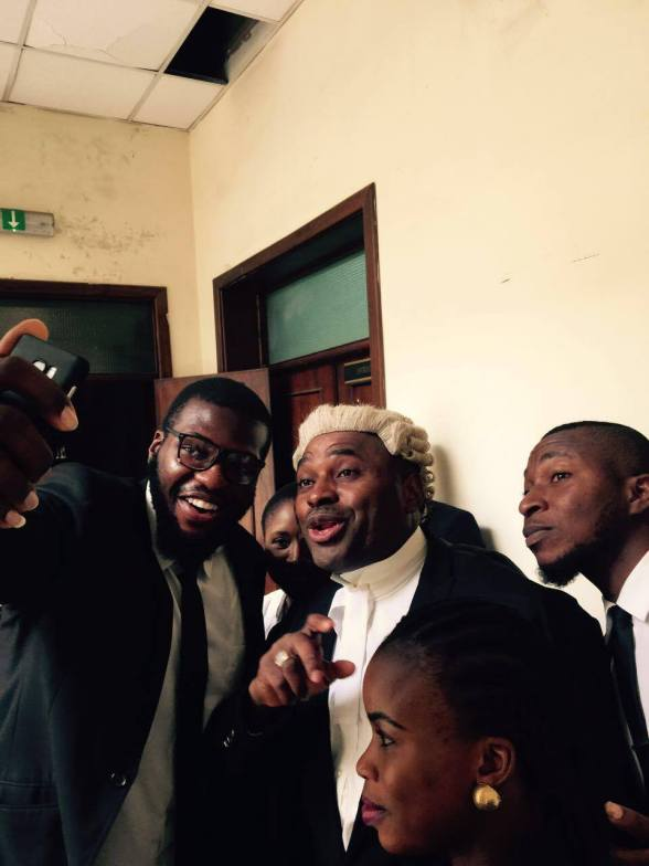 Fans and Lawyers taking selfies with Barrister Kenneth Okonkwo