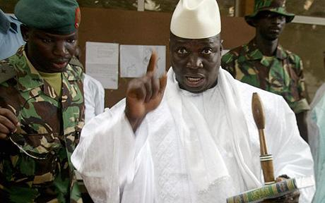 Gambia's President Yahya Jammeh shows hi...Banjul, GAMBIA:  Gambia's President Yahya Jammeh shows his fingers with ink after casting his vote during the presidential elections 22 September 2006 in Banjul. Gambians voted today in elections in which President Yahya Jammeh, who seized power in a coup 12 years ago, is tipped to win a third term to run the tiny west African country that is regularly criticised for its media repression. AFP PHOTO SEYLLOU   (Photo credit should read SEYLLOU/AFP/Getty Images)