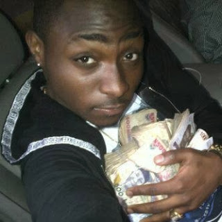 Image result for davido carrying money